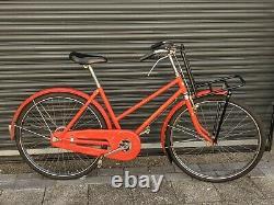Maruishi Cargo Bike. Postal Bike Japan. Red Japanese Carrier Working Mamachari