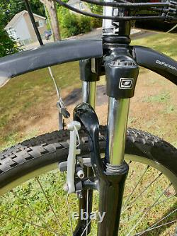 Montague X50 folding mountain bike with carrier, rear bag and carrying bag